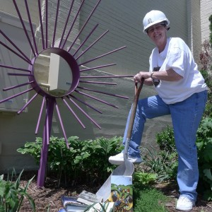 voluteer working in gardens at Fishersville Library