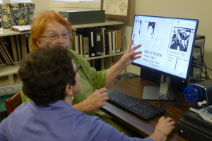 Librarian assisting woman with new microfilm reader